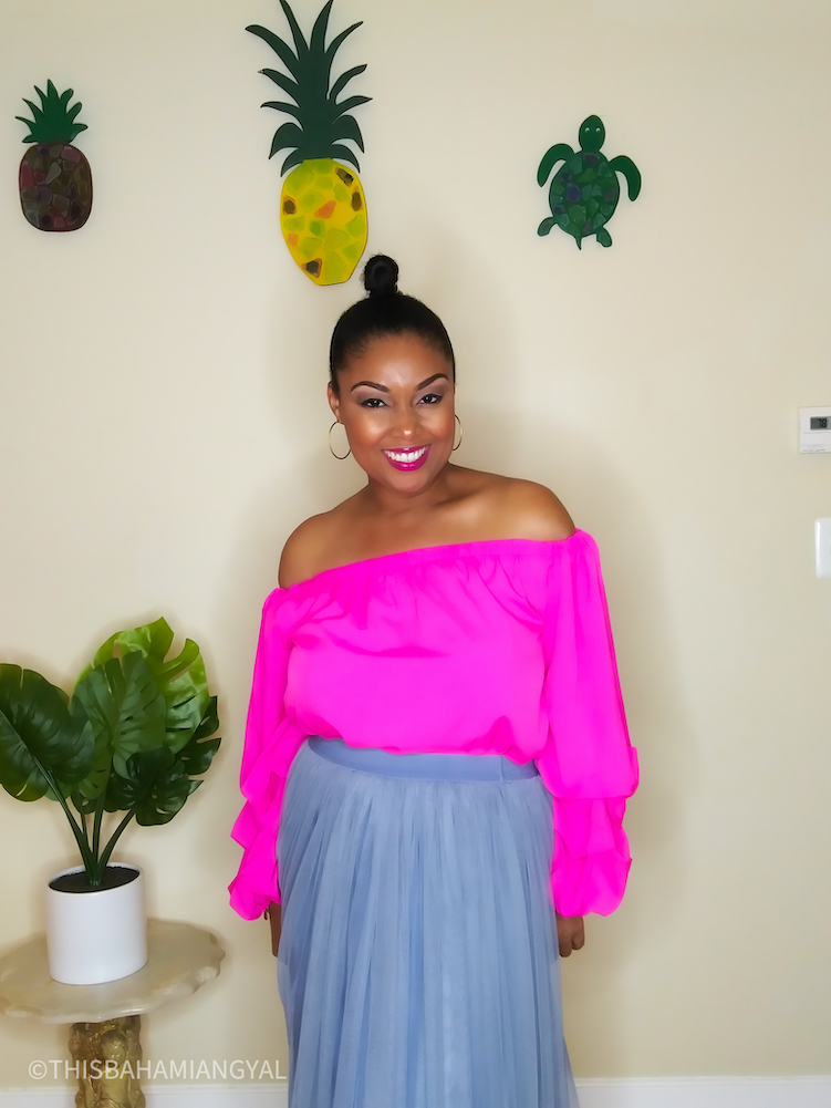 DC-based blogger, Rogan Smith wears a pink  off-the-shoulder blouse with a grey/blue tulle skirt.