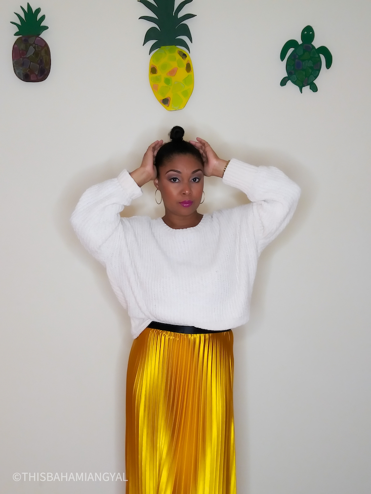 Black Washington, DC blogger, Rogan Smith wears a beautiful mustard coloured midi skirt with a cream coloured sweater from Altar'd State.