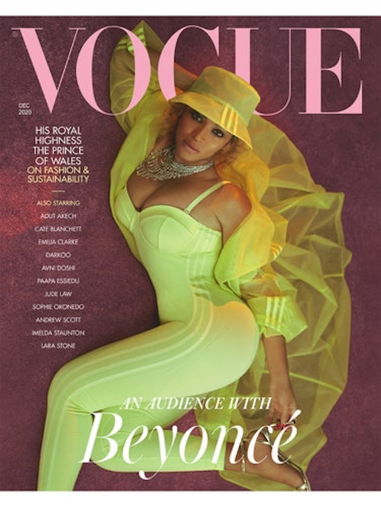 Photo of Beyonce Knowles on the cover of British Vogue. She is wearing a neon green outfit and a green hat.