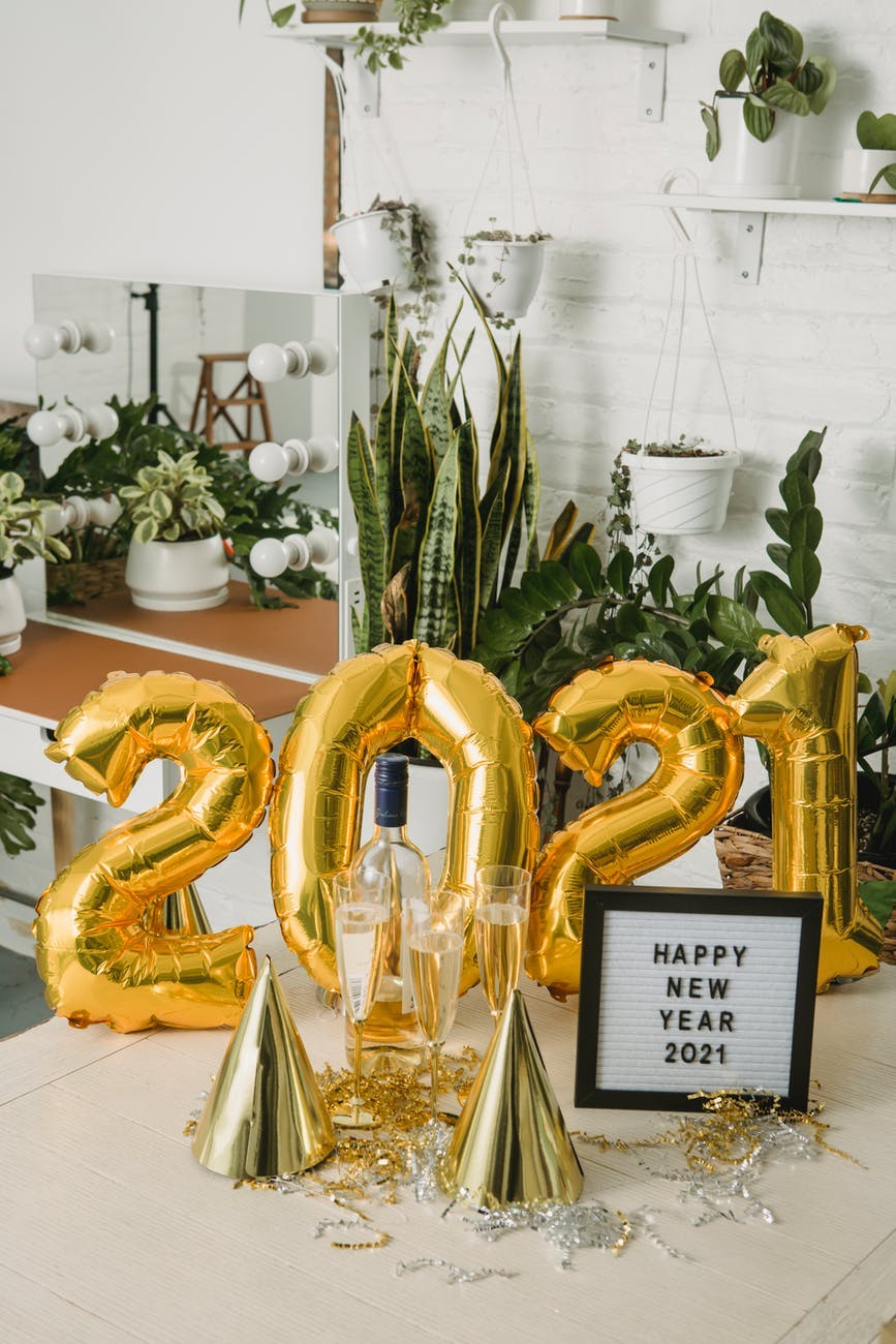 Image of 2021 balloons and sign saying Happy New Year