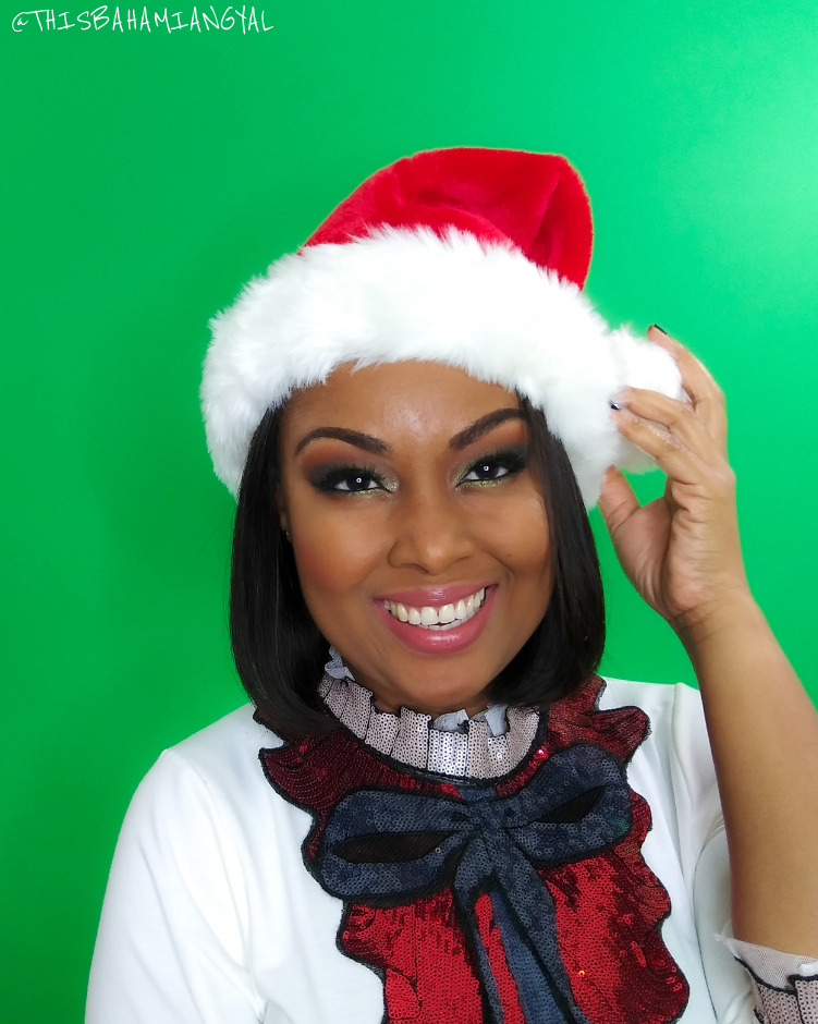 Blogger Rogan Smith wears a Santa Claus hat and outfit