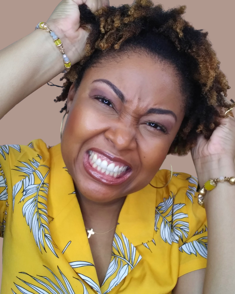 black woman shows her natural 4c hair twistout