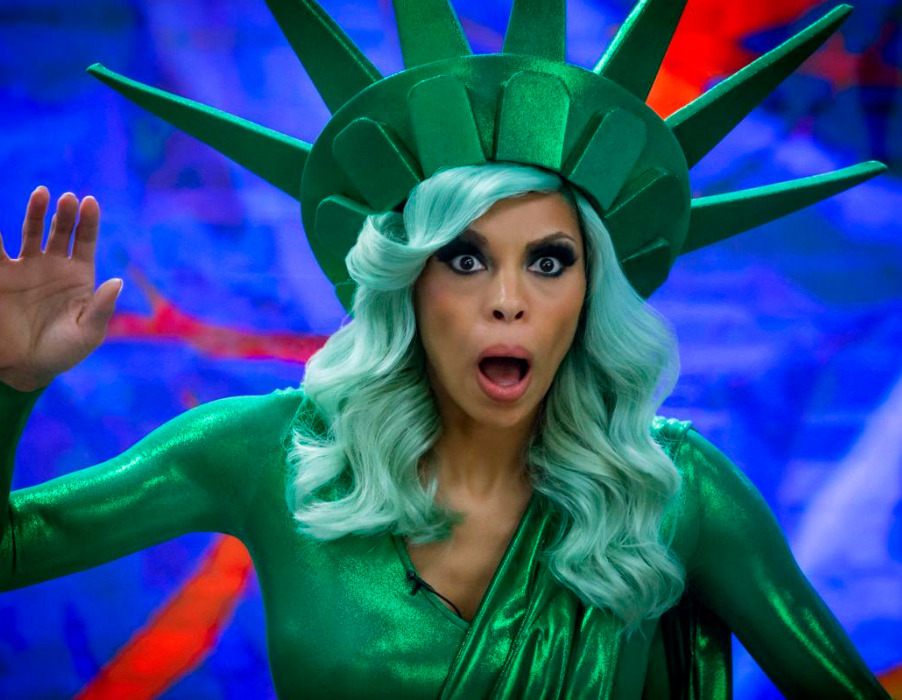 Actress Ciera Payton poses in a Statue of Liberty costume in the Wendy Williams movie on Lifetime