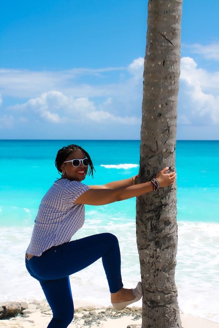 This Bahamian Gyal blogger, Rogan Smith on a beach in Exuma, The Bahamas.