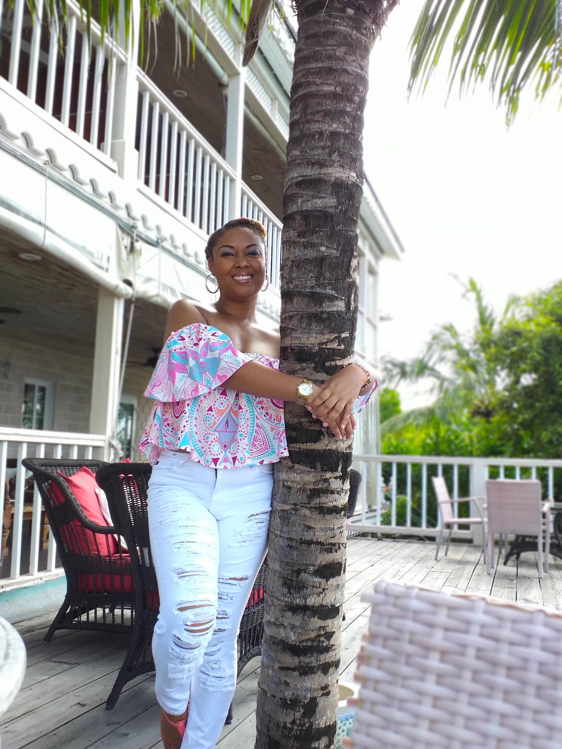 Rogan Smith This Bahamian Gyal black woman hugs tree in Nassau, Bahamas