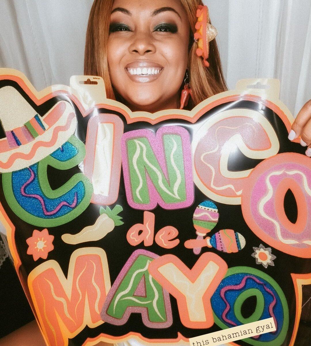 This Bahamian Gyal blogger, Rogan Smith poses with a Cinco de Mayo sign