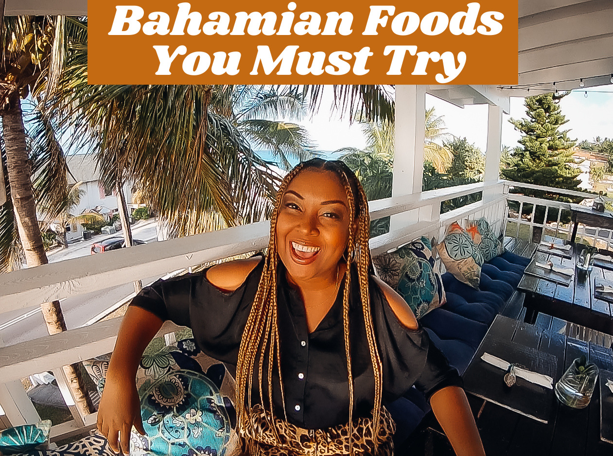 Photo of Bahamian blogger Rogan Smith sitting in a restaurant smiling