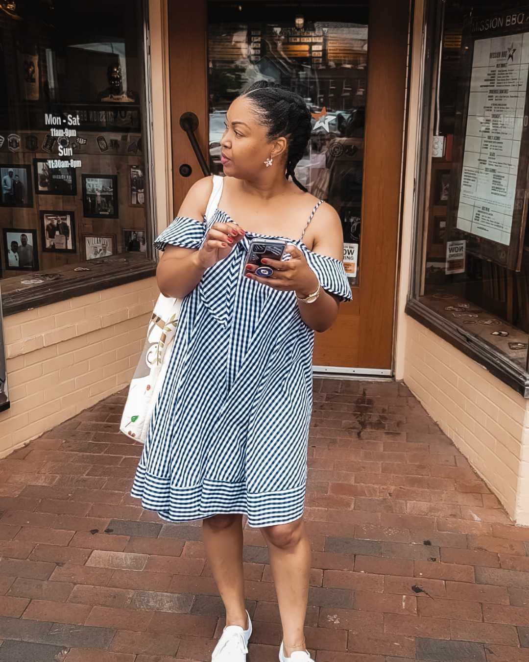 DC blogger Rogan Smith wears a blue and white babydoll dress as she stands in downtown Annapolis in Maryland