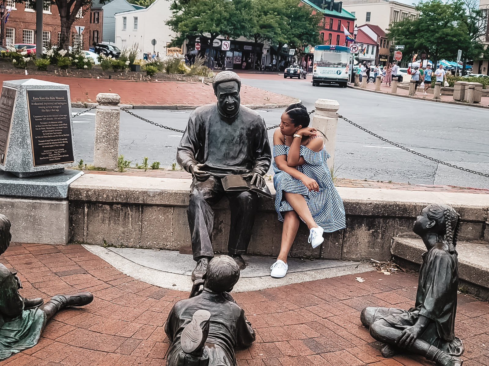 DC blogger Rogan Smith leans in to the Alex Haley - Kunta Kinte monument in Annapolis Maryland