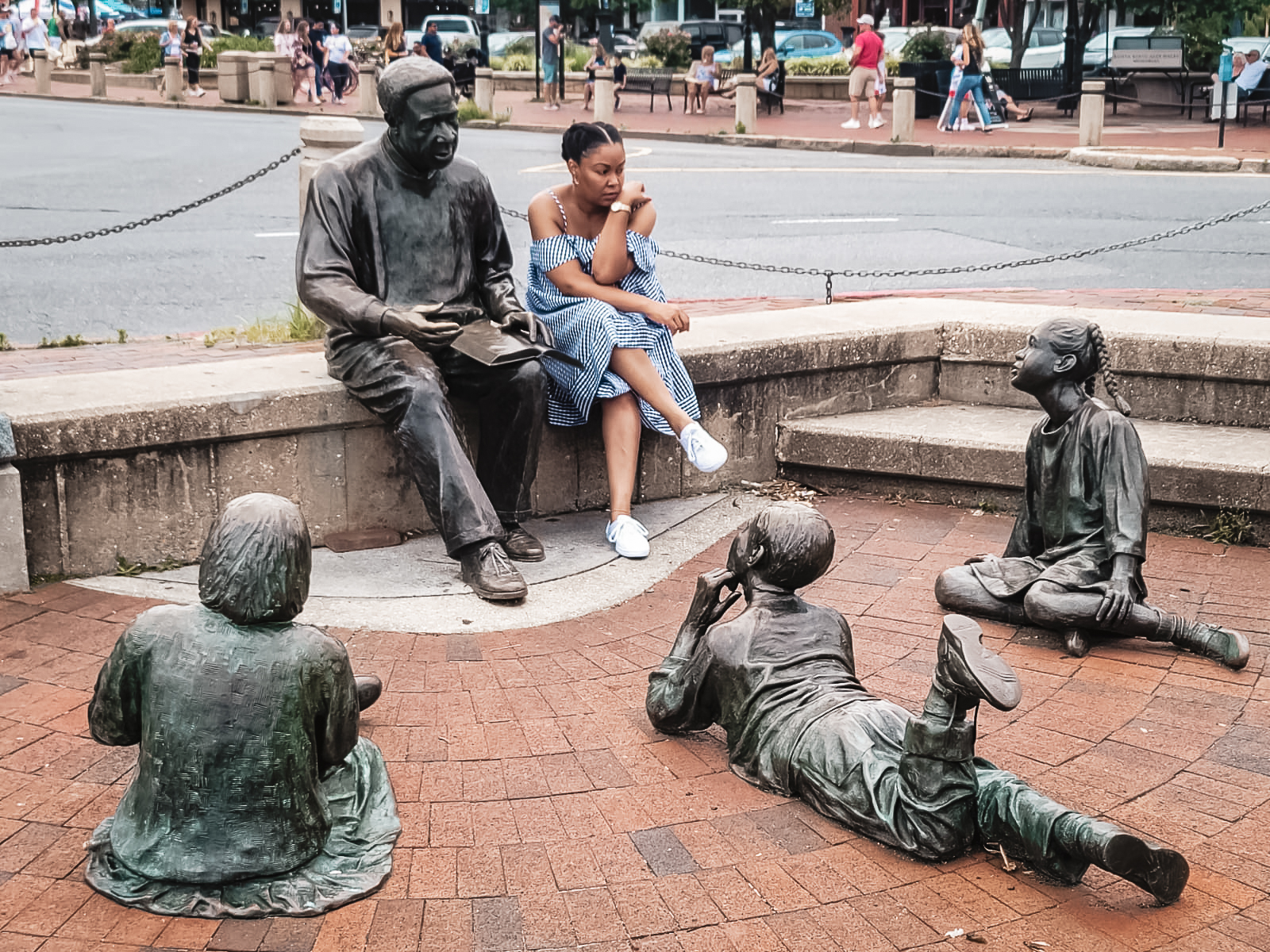 DC blogger Rogan Smith sits at the Alex Haley monument in Annapolis, Maryland
