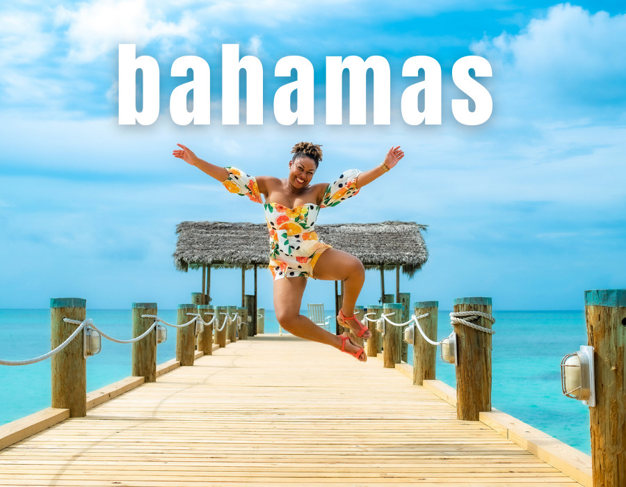 Bahamian blogger Rogan Smith jumps in the air on the pier at Compass Point in Nassau, Bahamas