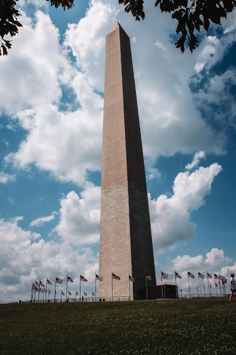 Image of the 555' white and beige Washington Monument in Washington DC