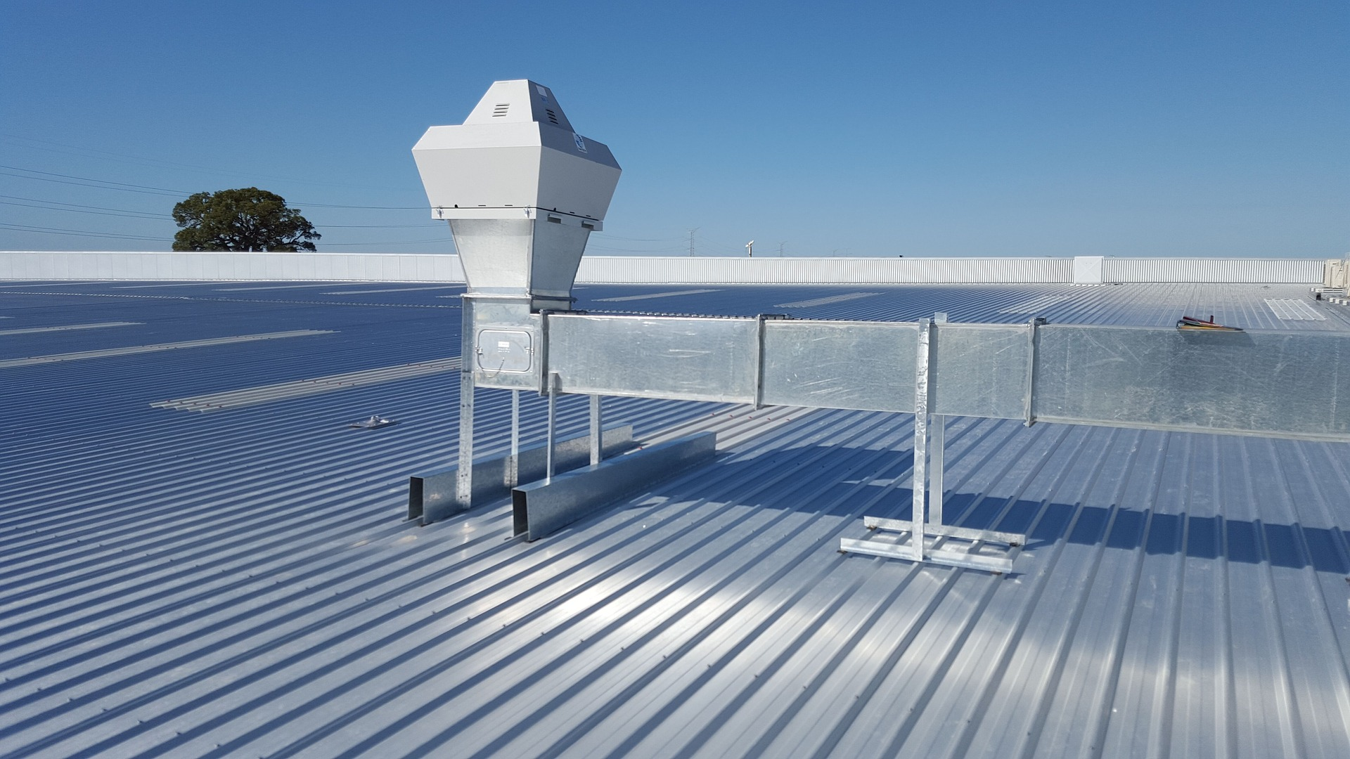 commercial air conditioning on a flat tin roof