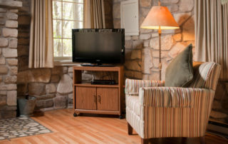 Studio stone fireplace, with chair and TV