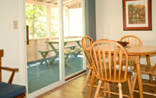 The Eagle's Nest screened-in porch with picnic table