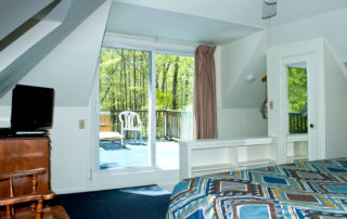 The Eagle's Nest master suite with a king bed and private sundeck