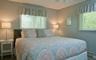Falun House master suite with a king bed and master bath