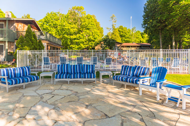 Blue striped deck chairs on stone patio