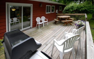 Falun House deck with gas grill and picnic table