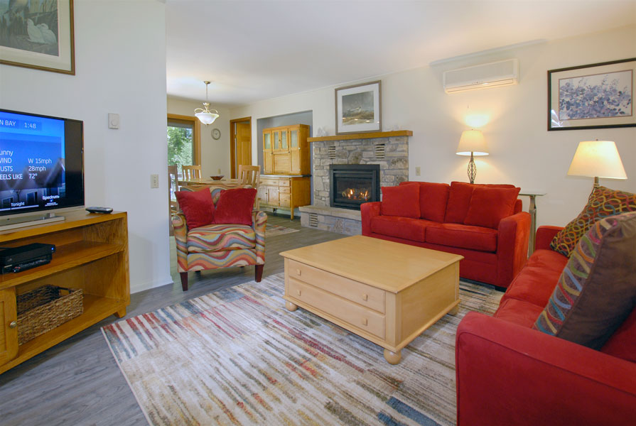 Falun house living room with red sofa and chairs and television