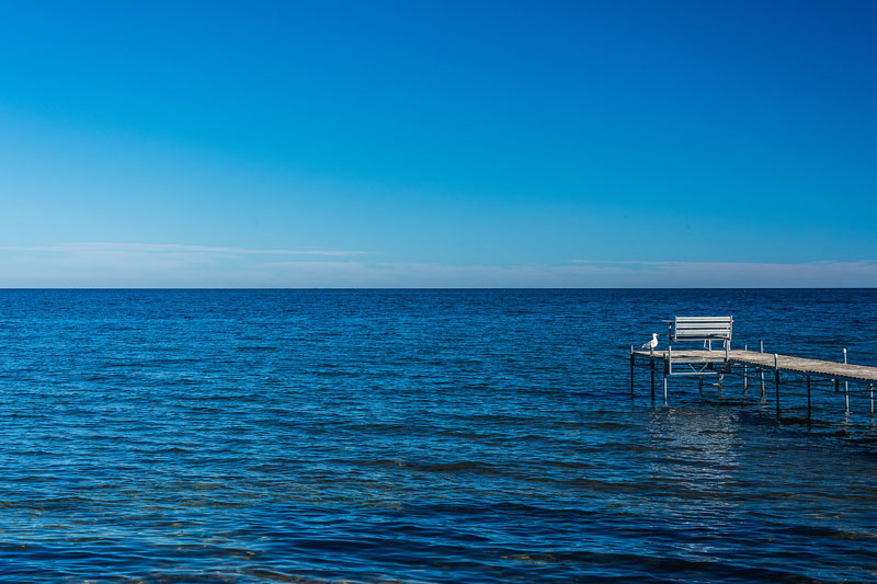 Pier extending out into bright blue water