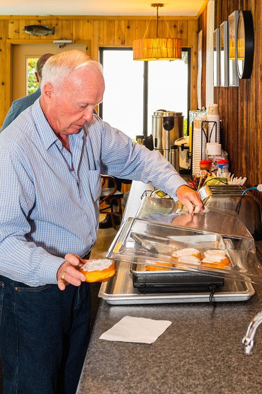 Man enjoying complimentary breakfast at the Shallows Resort