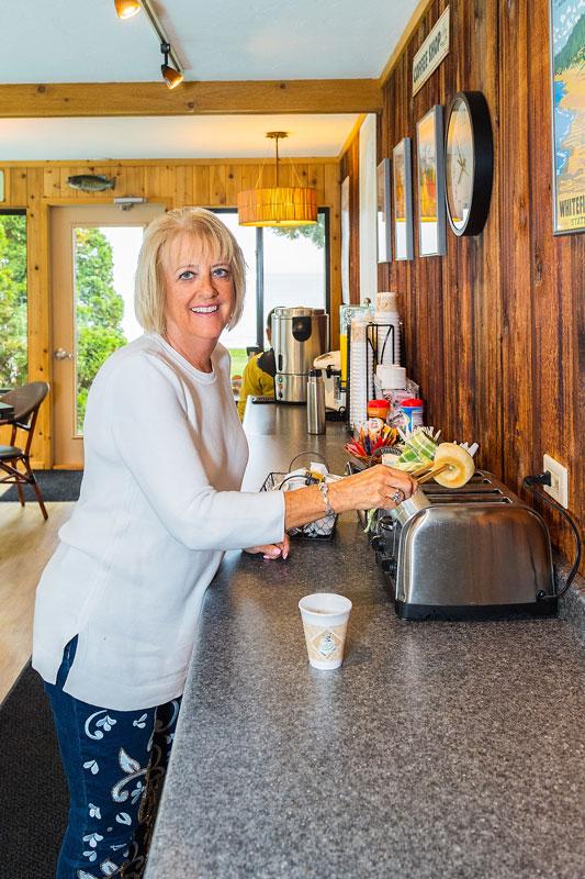 Woman enjoying complimentary breakfast bagel