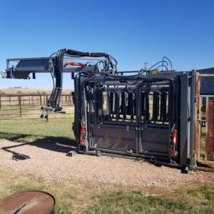 SILENCER Hydraulic Chute with Crash Cage Lifted