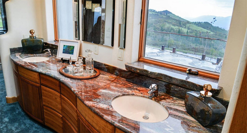 The master bath features double sinks with the distinctive curved counter