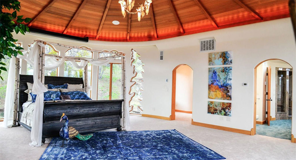 Upstairs, the master suite overlooks the valley with incredible views from a wall of windows.