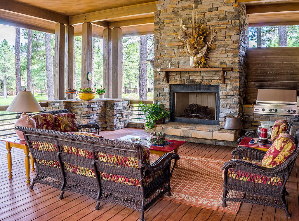 Covered Porch Brick Fireplace