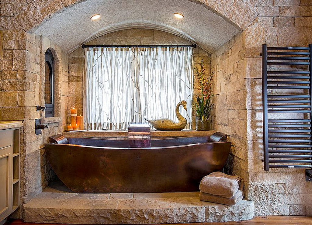 Custom Copper Bathtub Against a Natural Stone Backdrop