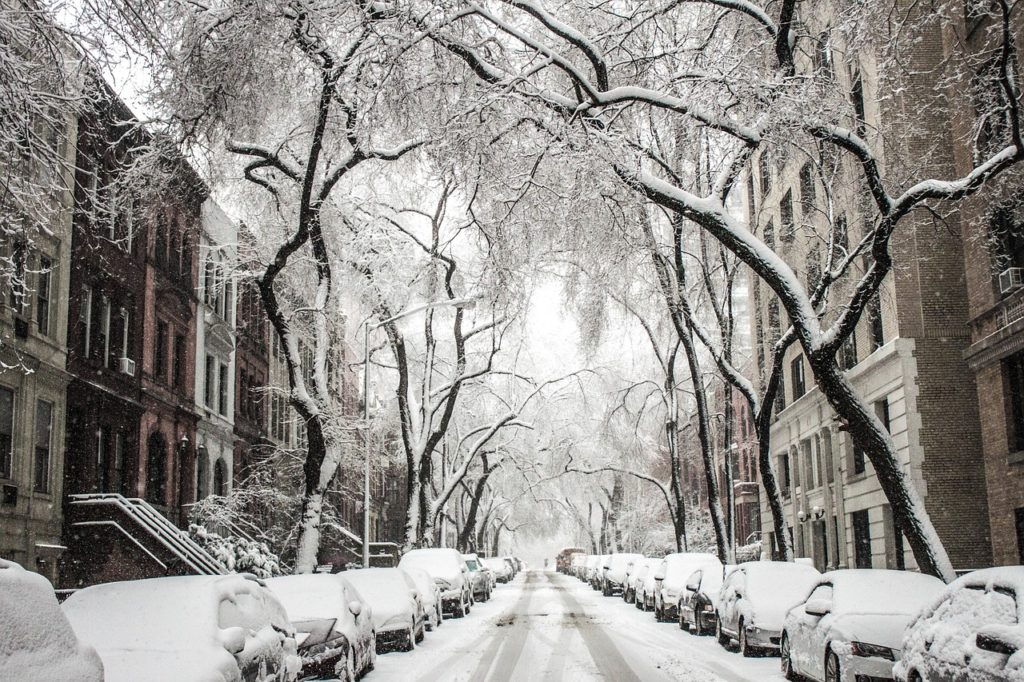 Snow Blanketed City Street Winter Scene
