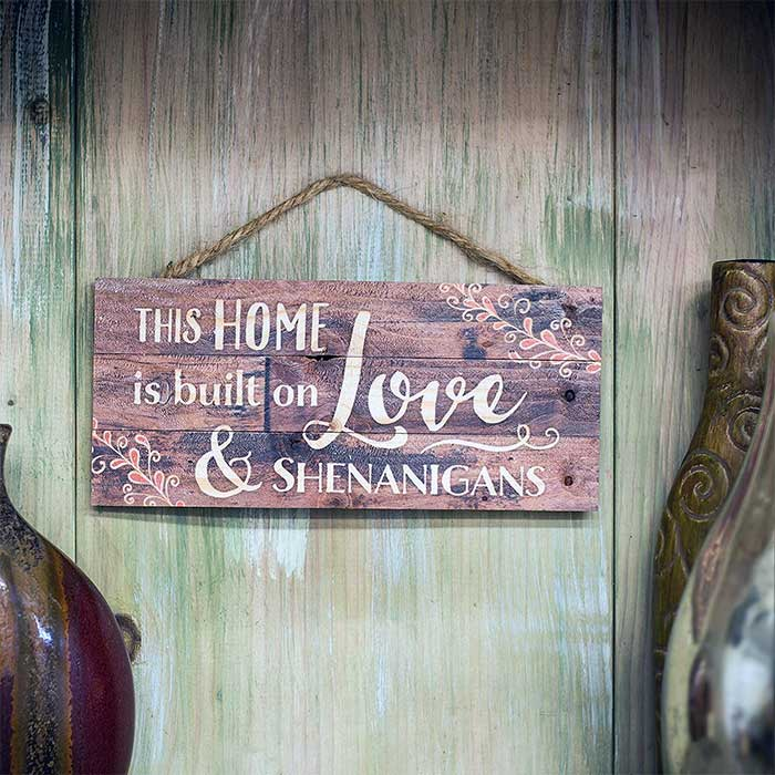 This Home is Built on Love and Shenanigans Distressed Wood Plank Sign