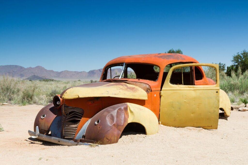 Abandoned Car Buried in Sand