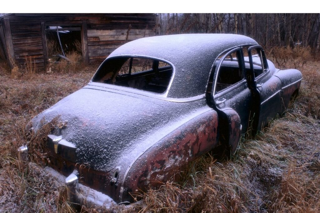 Abandoned Car Dusted with Snow