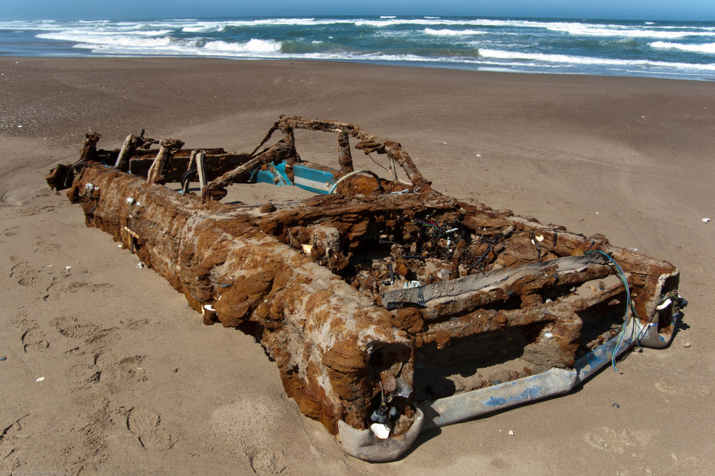 Vintage station wagon that washed up on the shore after a big storm