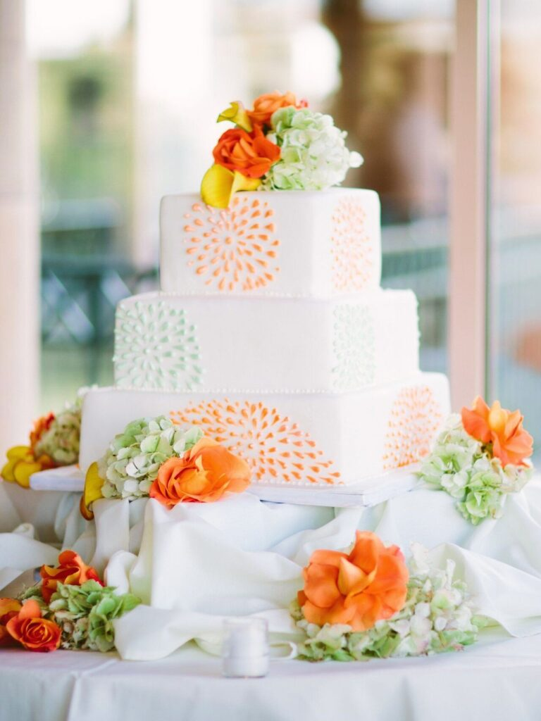 Bursting With Color White Orange Green Wedding Cake photo by Memorie Studio