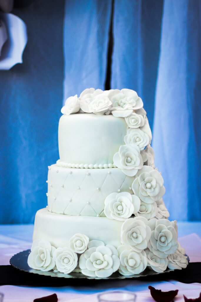 Cascading White Roses Wedding Cake