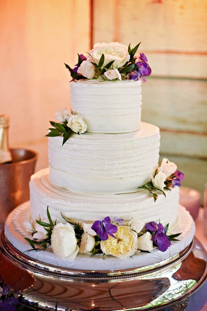 Classic White Ribbons Wedding Cake with Flowers