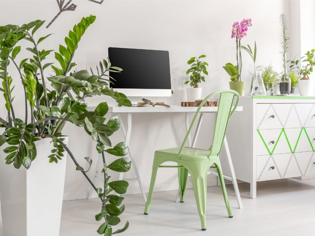 A little workstation in the corner provides a pop of green
