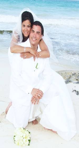 Beach Wedding: Groom feeling comfortable as ever in his pure white, fine linen, breathable Guayabera
