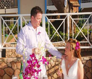 Destination Wedding: Bride adoring her Husband's choice of the light and cool attire, as they raise their wedding toast
