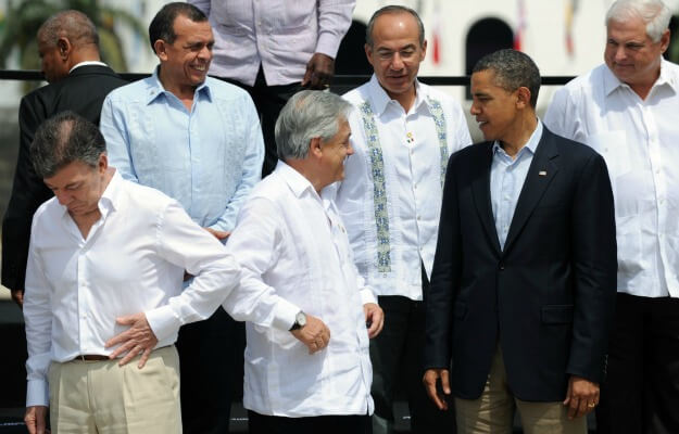 Former US President, Barrack Obama along with some members of the Cuban Ministry attired in Guayaberas; captured in a photo at the American Summit