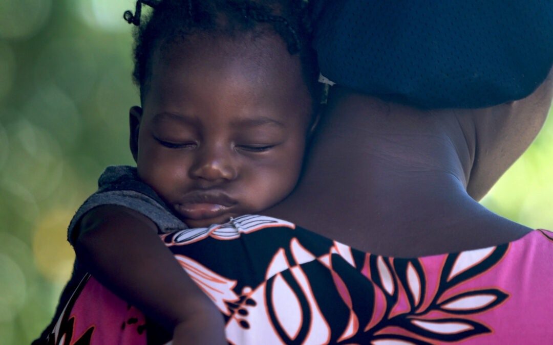 black teen with newborn