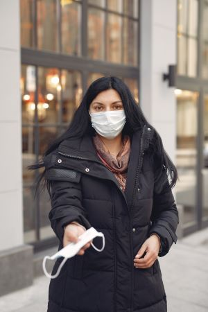 Copy - Woman in Black Leather Jacket Wearing White Mask