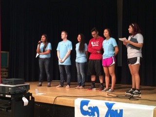 Jenny Nuñez, along with MGC officers, makes an announcement at Fall into Fall.