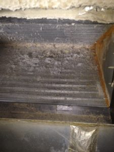 This is the underside of an indoor A/C coil.  Keeping your filters changed will prevent this.