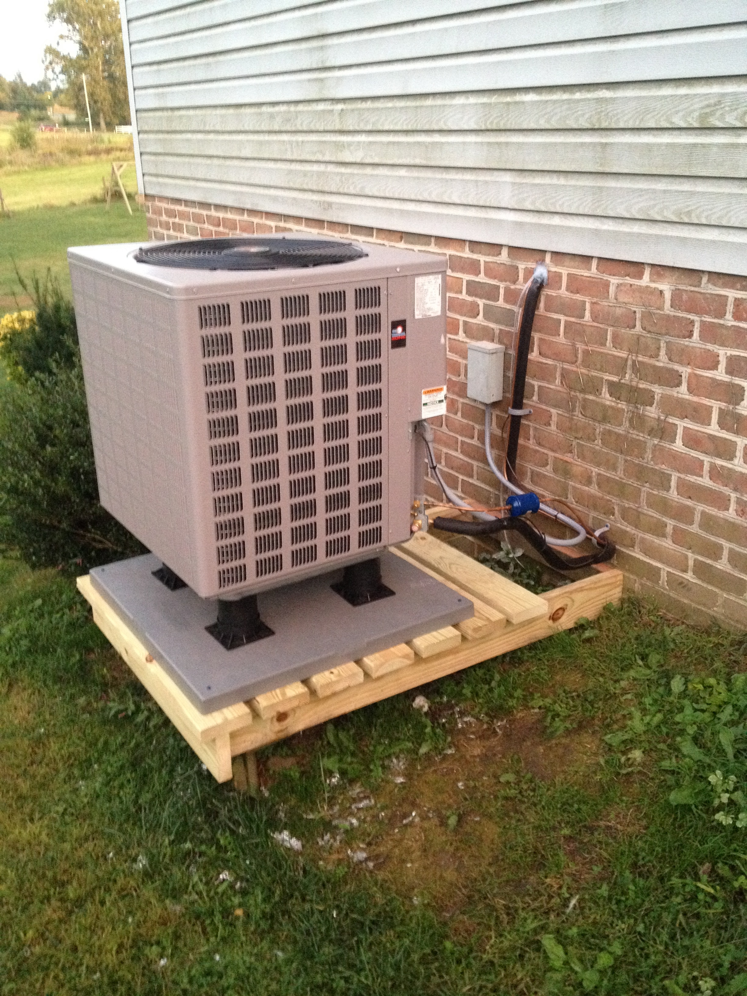 I built this nice platform out of treated lumber to get this heat pump unit off the ground.