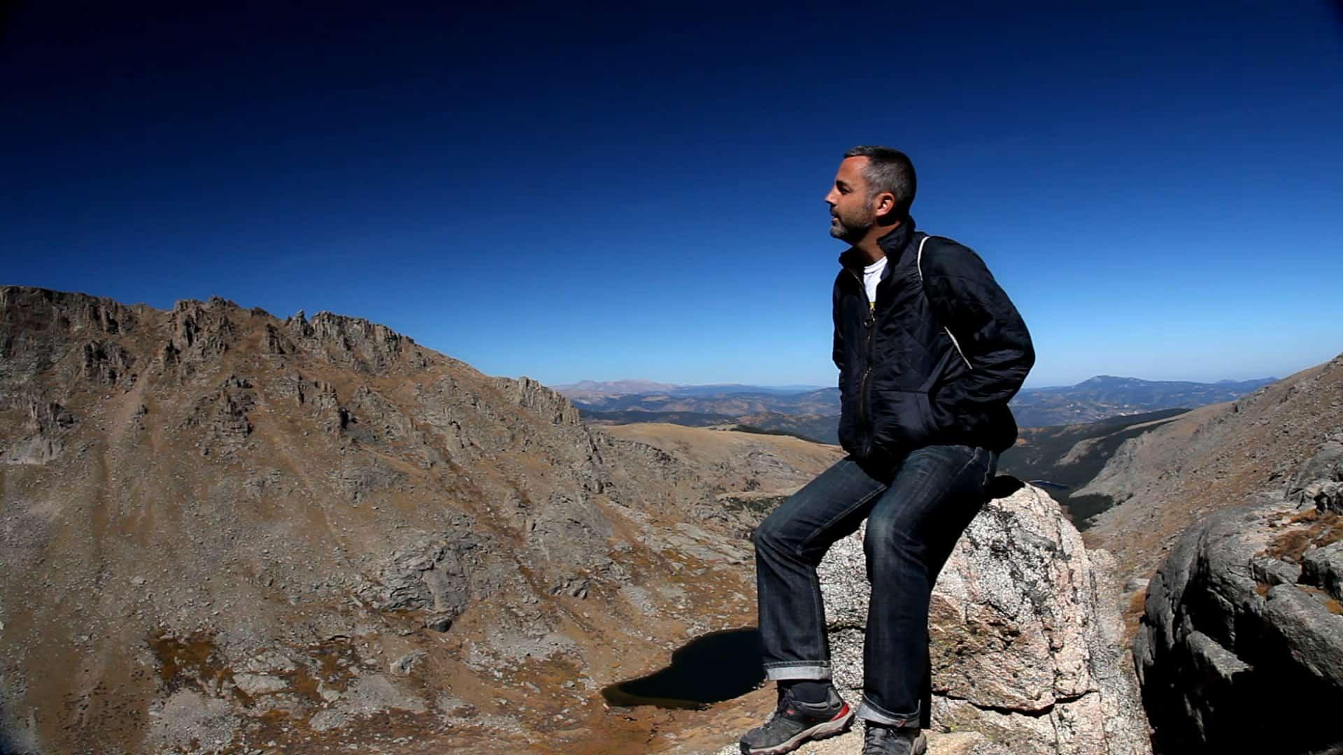 still of man at mountain top